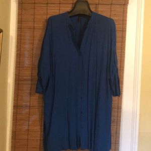 Tunic style blouse with pockets tab sleeve